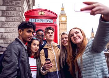 Group of young teenagers enjoying a school trip in London, they're visiting Westminster areas.